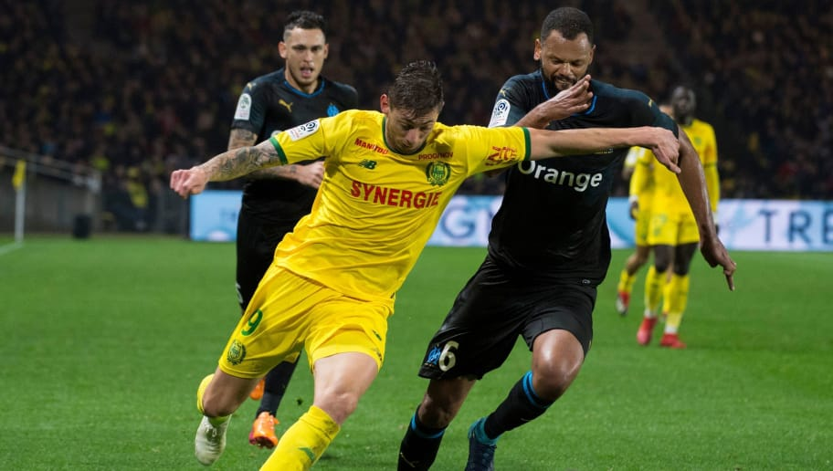 Nantes' Argentine forward Emiliano Sala (L) vies for the ball with Marseille's Portuguese defender Rolando (R) during the French L1 football match between FC Nantes and Olympique de Marseille at the La Beaujoire stadium in Nantes, western France on December 5, 2018. (Photo by SEBASTIEN SALOM GOMIS / AFP)        (Photo credit should read SEBASTIEN SALOM GOMIS/AFP/Getty Images)