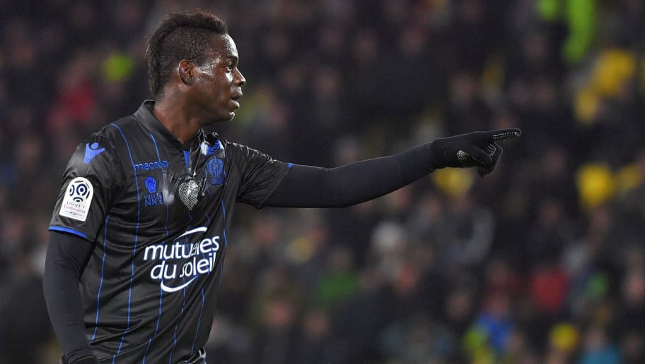 Nice's Italian forward Mario Balotelli celebrates after scoring a goal during the French L1 football match Nantes vs Nice at the La Beaujoire stadium in Nantes, western France, on December 10, 2017.    / AFP PHOTO / LOIC VENANCE        (Photo credit should read LOIC VENANCE/AFP/Getty Images)