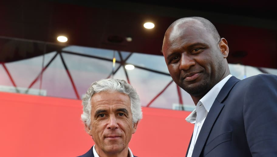 French former Arsenal and France star Patrick Vieira (R), world and European champion with Les Bleus, poses with French L1 football club of OGC Nice's president Jean-Pierre Rivere (R) at the end of a press conference after being officialy appointed the club's new coach on June 11, 2018 in Nice. - Vieira, 41, arrives after a stint at MLS outfit New York City FC. He has signed a three-year contract and replaces Lucien Favre who is moving to Borussia Dortmund. (Photo by YANN COATSALIOU / AFP)        (Photo credit should read YANN COATSALIOU/AFP/Getty Images)