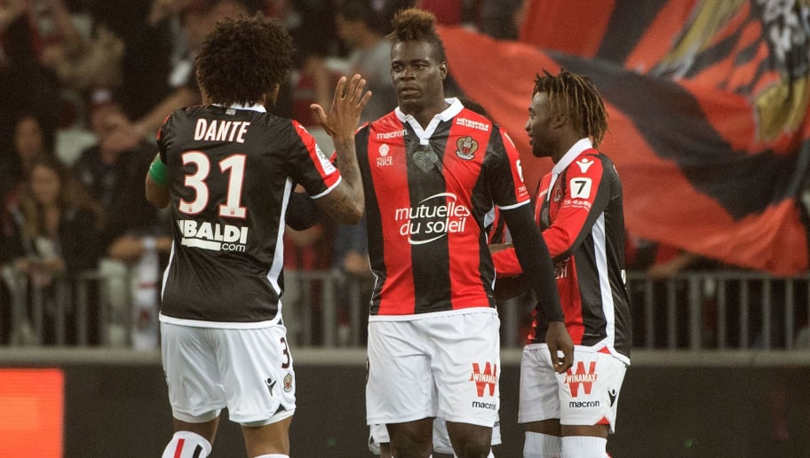 Nice's Italian forward Mario Balotelli (C) celebrates after scoring during the French L1 football match Nice vs Caen on May 12, 2018 at the Allianz Rivieira in Nice, southeastern France. (Photo by BERTRAND LANGLOIS / AFP)        (Photo credit should read BERTRAND LANGLOIS/AFP/Getty Images)
