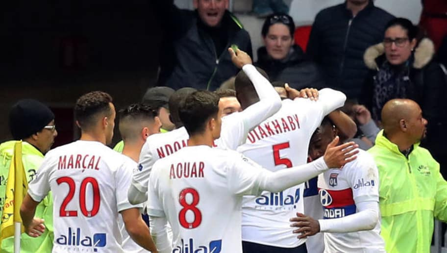 A bottle flies through the air as Lyon's French forward Myziane Maolida celebrates with teammates after scoring a goalduring the French L1 football match Nice vs Lyon at The 'Allianz Riviera' Stadium in Nice, southeastern France on November 26, 2017.   / AFP PHOTO / VALERY HACHE        (Photo credit should read VALERY HACHE/AFP/Getty Images)