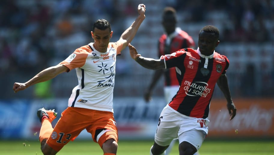 Montpellier's French midfielder Ellyes Skhiri (L) vies with Nice's Ivorian midfielder Jean Michael Seri (R) on April 22, 2018 at the Allianz Riviera Stadium in Nice, southern France, during the French L1 football match Nice vs Montpellier. (Photo by ANNE-CHRISTINE POUJOULAT / AFP)        (Photo credit should read ANNE-CHRISTINE POUJOULAT/AFP/Getty Images)