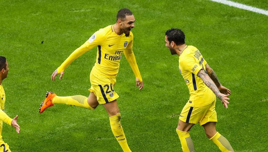 Paris Saint-Germain's Brazilian defender Dani Alves (R) celebrates with Paris Saint-Germain's French defender Layvin Kurzawa (C) and Paris Saint-Germain's Brazilian defender Thiago Silva after he scored the winning goal during the French L1 football match Nice (OGCN) vs Paris Saint-Germain (PSG) on March 18, 2018 at the Allianz Riviera stadium in Nice. / AFP PHOTO / Valery HACHE        (Photo credit should read VALERY HACHE/AFP/Getty Images)