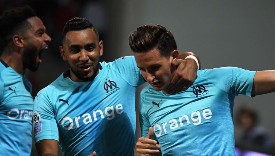 Olympique Marseille's French midfielder Florian Thauvin (R) celebrates with teammates after scoring a goal during the French L1 football match between Nimes and Marseille at The Costières Stadium in Nimes, southern France on August 19, 2018. (Photo by PASCAL GUYOT / AFP)        (Photo credit should read PASCAL GUYOT/AFP/Getty Images)