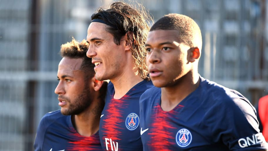 Paris Saint-Germain's French forward Kylian Mbappe (R) celebrates with Paris Saint-Germain's Uruguayan forward Edinson Cavani (C) and Paris Saint-Germain's Brazilian forward Neymar Jr (L) after scoring their third goal during the French L1 football match between Nimes and Paris Saint-Germain (PSG), on September 1, 2018 at the Costieres stadium in Nimes, southern France. (Photo by PASCAL GUYOT / AFP)        (Photo credit should read PASCAL GUYOT/AFP/Getty Images)