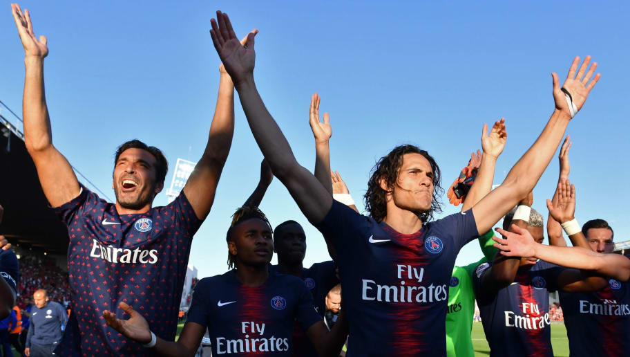 (FromL) Paris Saint-Germain's Italian goalkeeper Gianluigi Buffon, Paris Saint-Germain's French midfielder Christopher Nkunku and Paris Saint-Germain's Uruguayan forward Edinson Cavani celebrate their victory after the French L1 football match between Nimes and Paris Saint-Germain (PSG), on September 1, 2018 at the Costieres stadium in Nimes, southern France. (Photo by Pascal GUYOT / AFP)        (Photo credit should read PASCAL GUYOT/AFP/Getty Images)