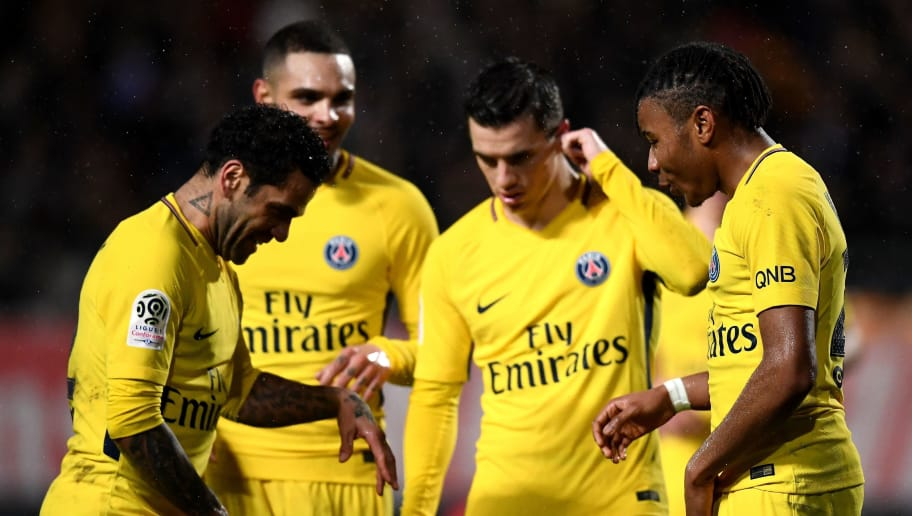 Paris Saint-Germain's French midfielder Christopher Nkunku (1st-R) celebrates his goal with Paris Saint-Germain's Brazilian defender Dani Alves (1st-L), Paris Saint-Germain's French defender Layvin Kurzawa (2nd-L) and Paris Saint-Germain's Argentinian midfielder Giovanni Lo Celso (2nd-R) during the French L1 football match between Troyes and Paris Saint-Germain at the Aube Stadium in Troyes on March 3, 2018. / AFP PHOTO / FRANCK FIFE        (Photo credit should read FRANCK FIFE/AFP/Getty Images)