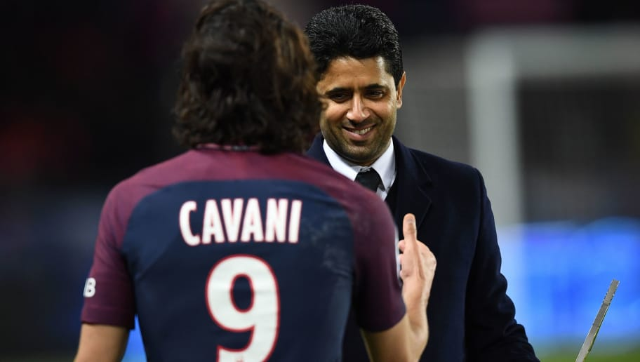 Paris Saint-Germain's Uruguayan forward Edinson Cavani (L) his congratulated by Paris Saint-Germain's Qatari president Nasser Al-Khelaifi for scoring 157 goals with Paris Saint-Germain and becoming top scorer in the club's history after the French L1 football match between Paris Saint-Germain (PSG) and Montpellier (MHSC) at the Parc des Princes stadium in Paris on January 27, 2018. / AFP PHOTO / FRANCK FIFE        (Photo credit should read FRANCK FIFE/AFP/Getty Images)