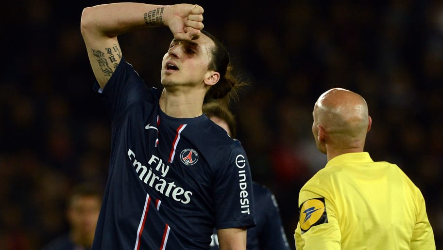 Paris Saint-Germain's Swedish forward Zlatan Ibrahimovic gestures next to referee Tony Chapron during the French L1 football match Paris Saint-Germain (PSG) vs Nice, on April 21, 2013 at the Parc des Princes stadium in Paris. AFP PHOTO / FRANCK FIFE        (Photo credit should read FRANCK FIFE/AFP/Getty Images)