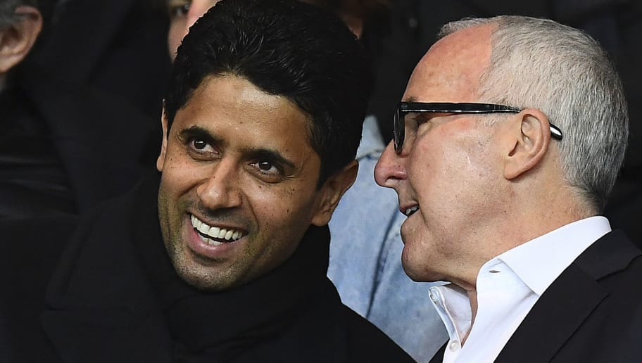 Paris Saint-Germain's Qatari president Nasser Al-Khelaifi (L) speaks with Olympique de Marseille new owner Frank McCourt during the French L1 football match between Paris Saint-Germain (PSG) and Olympique de Marseille (OM) at the Parc de Princes stadium, western Paris, on October 23, 2016.  / AFP PHOTO / FRANCK FIFE        (Photo credit should read FRANCK FIFE/AFP/Getty Images)