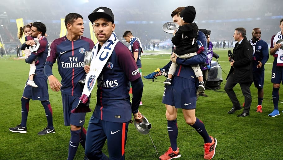 Paris Saint-Germain's Brazilian forward Neymar (C) walks on the pitch with teammates after winning the French L1 title at the end of the French L1 football match Paris Saint-Germain (PSG) vs Rennes at The Parc des Princes Stadium in Paris on May 12, 2018. (Photo by FRANCK FIFE / AFP)        (Photo credit should read FRANCK FIFE/AFP/Getty Images)