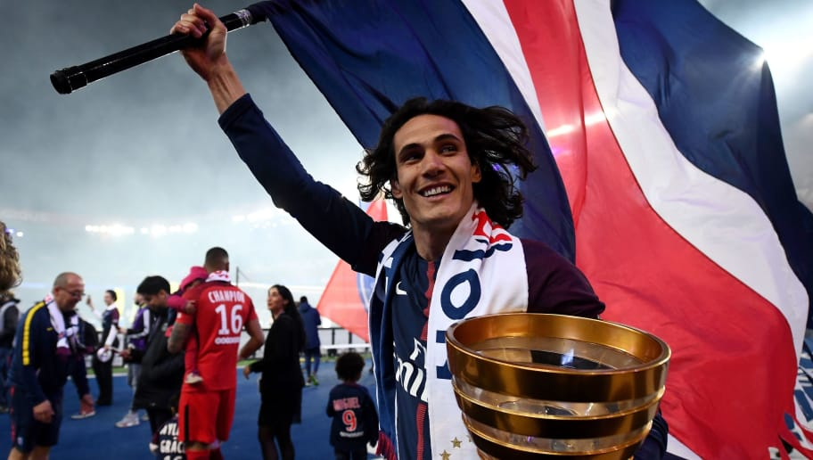 Paris Saint-Germain's Uruguayan forward Edinson Cavani celebrates after winning the French L1 title at the end of the French L1 football match Paris Saint-Germain (PSG) vs Rennes on May 12, 2018 at the Parc des Princes stadium in Paris. (Photo by FRANCK FIFE / AFP)        (Photo credit should read FRANCK FIFE/AFP/Getty Images)