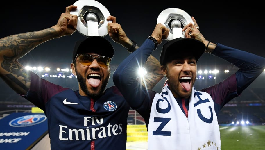 Paris Saint-Germain's Brazilian defender Dani Alves (L) and Paris Saint-Germain's Brazilian forward Neymar joke after winning the French L1 title at the end of the French L1 football match Paris Saint-Germain (PSG) vs Rennes on May 12, 2018 at the Parc des Princes stadium in Paris. (Photo by FRANCK FIFE / AFP)        (Photo credit should read FRANCK FIFE/AFP/Getty Images)