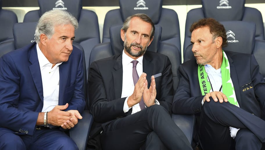 Saint-Etienne's president Roland Romeyer (R), Paris Saint-Germain's assistant general manager Jean Claude Blanc (C) and Saint-Etienne's president of the supervisory Board, Bernard Caiazzo speak during the French L1 football match between Paris Saint-Germain and Saint-Etienne at the Parc des Princes stadium in Paris on September 9, 2016. / AFP PHOTO / FRANCK FIFE        (Photo credit should read FRANCK FIFE/AFP/Getty Images)
