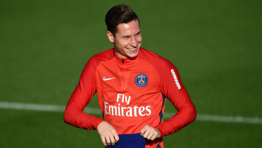 Paris Saint-Germain's German midfielder Julian Draxler smiles during a training session on October 12, 2017 at the Oredoo training center in Saint-Germain-en-Laye, west of Paris.  / AFP PHOTO / FRANCK FIFE        (Photo credit should read FRANCK FIFE/AFP/Getty Images)