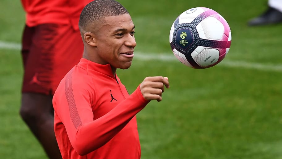 Paris Saint-Germain's French forward Kylian Mbappe takes part in a training session at the team's 'Camp des Loges' training grounds in Saint-Germain-en-Laye, west of Paris, on September 13, 2018, on the eve of the French L1 football match between Paris Saint-Germain (PSG) and Saint-Etienne (ASSE). (Photo by Anne-Christine POUJOULAT / AFP)        (Photo credit should read ANNE-CHRISTINE POUJOULAT/AFP/Getty Images)