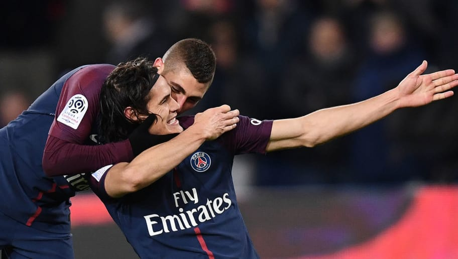 Paris Saint-Germain's Uruguayan forward Edinson Cavani (R) celebrates with Paris Saint-Germain's Italian midfielder Marco Verratti after scoring a goal during the French L1 football match between Paris Saint-Germain (PSG) and Troyes at the Parc des Princes stadium in Paris on November 29, 2017.  / AFP PHOTO / FRANCK FIFE        (Photo credit should read FRANCK FIFE/AFP/Getty Images)