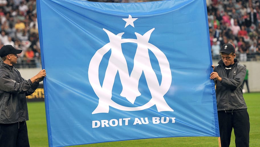 Two boys hold the Olympique de Marseille' football club official flag prior to the French L1 football match Reims (SR) vs Marseille (OM), on August 12, 2012 at the Auguste Delaune stadium in Reims, eastern France. AFP PHOTO/ PHILIPPE HUGUEN        (Photo credit should read PHILIPPE HUGUEN/AFP/GettyImages)