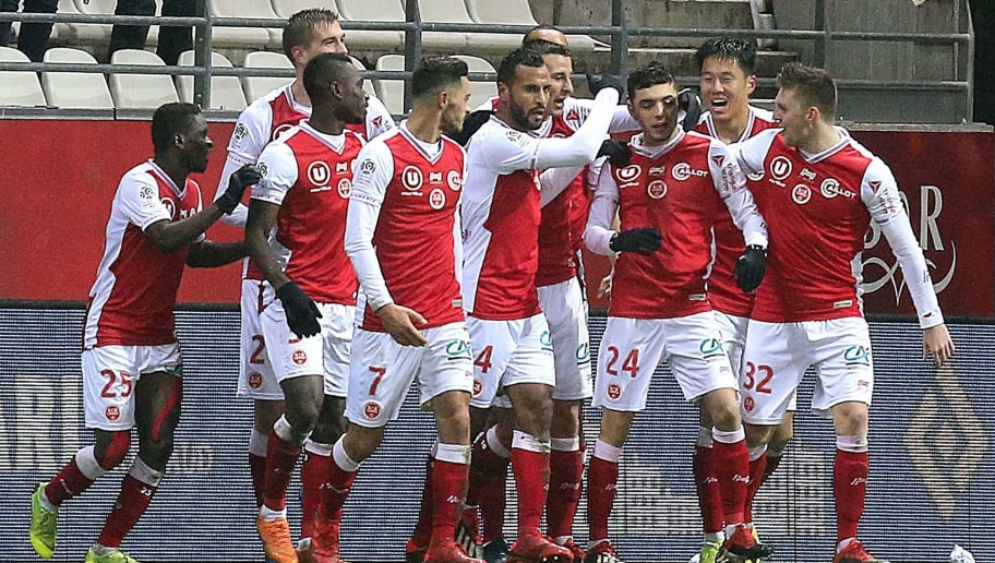 Reims' players celebrate after Reims' French midfielder Mathieu Cafaro (3rd R) scored during the French L1 football match between Stade de Reims and Racing Club Strasbourg Alsace at the Auguste Delaune Stadium in Reims, eastern France on December 15, 2018. (Photo by FRANCOIS NASCIMBENI / AFP)        (Photo credit should read FRANCOIS NASCIMBENI/AFP/Getty Images)