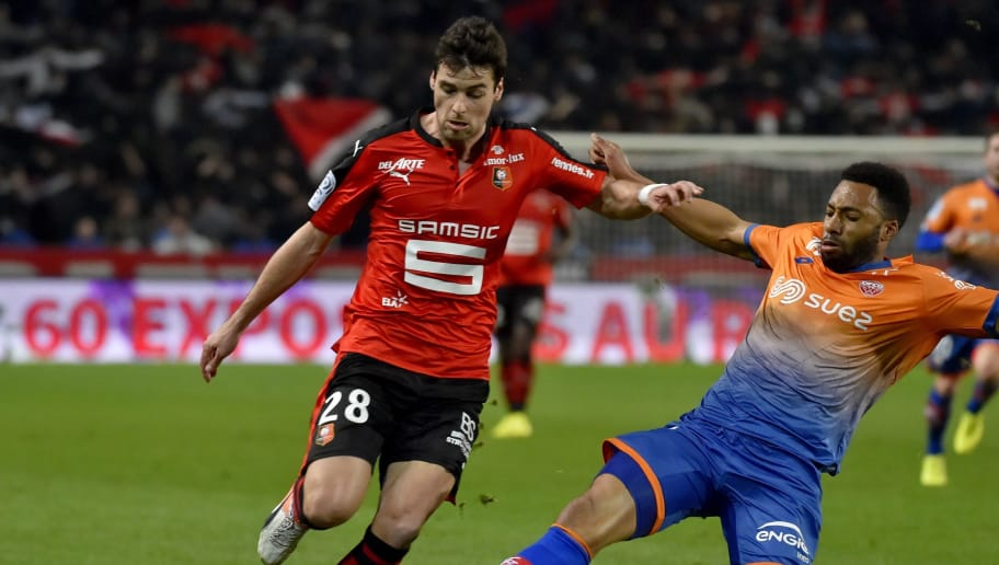 French defender Jordan Loties (R) tackles Rennes' French midfielder Yoann Gourcuff during the French L1 football match Rennes vs Dijon at the Roazhon Park stadium in Rennes, western France, on March 11, 2017.     / AFP PHOTO / LOIC VENANCE        (Photo credit should read LOIC VENANCE/AFP/Getty Images)