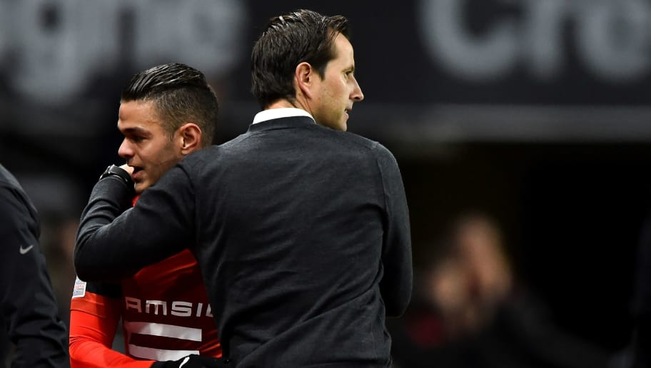 Rennes' French coach Julien Stephan (R) congatulates Rennes' French forward Hatem Ben Arfa (L) after scoring during the French L1 football match between Stade Rennais Football Club and Dijon Football Cote-D'Or at the Roazhon Park, in Rennes, northwestern France, on December 8, 2018. (Photo by JEAN-FRANCOIS MONIER / AFP)        (Photo credit should read JEAN-FRANCOIS MONIER/AFP/Getty Images)