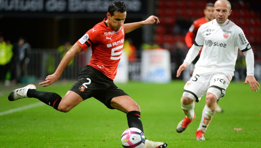 Rennes' Algerian defender Mehdi Zeffane (L) vies with Dijon's French midfielder Florent Balmont (R) during the French L1 football match between Stade Rennais Football Club and Dijon Football Cote-D'Or at the Roazhon Park, in Rennes, northwestern France, on December 8, 2018. (Photo by Jean-François MONIER / AFP)        (Photo credit should read JEAN-FRANCOIS MONIER/AFP/Getty Images)