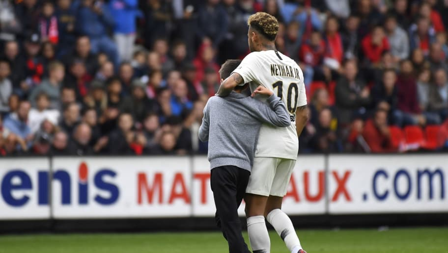 Paris Saint-Germain's Brazilian forward Neymar (R) comforts a young fan after his intrusion on the pitch to meet his favourite player during the French L1 football match between Rennes and Paris Saint-Germain at the Roazhon Park stadium in Rennes, on September 23, 2018. (Photo by DAMIEN MEYER / AFP)        (Photo credit should read DAMIEN MEYER/AFP/Getty Images)