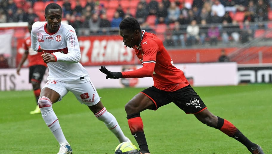 Rennes' French forward Ismaila Sarr (R) vies with Toulouse's French midfielder Giannelli Imbula during the French L1 football match Rennes vs Toulouse on April 29, 2018 at the Roazhon Park stadium in Rennes, northwestern France. (Photo by FRED TANNEAU / AFP)        (Photo credit should read FRED TANNEAU/AFP/Getty Images)
