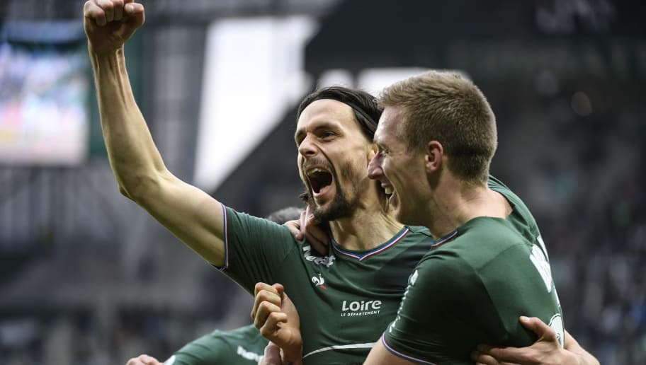 Saint-Etienne's Serbian defender Neven Subotic (C) is congratulated by  Saint-Etienne's Slovenian forward Robert Beric (R) after scoring a goal during the French L1 football match between AS Saint-Etienne and EA Guingamp, on March 18, 2018, at the Geoffroy Guichard stadium in Saint-Etienne, central France.    / AFP PHOTO / PHILIPPE DESMAZES        (Photo credit should read PHILIPPE DESMAZES/AFP/Getty Images)