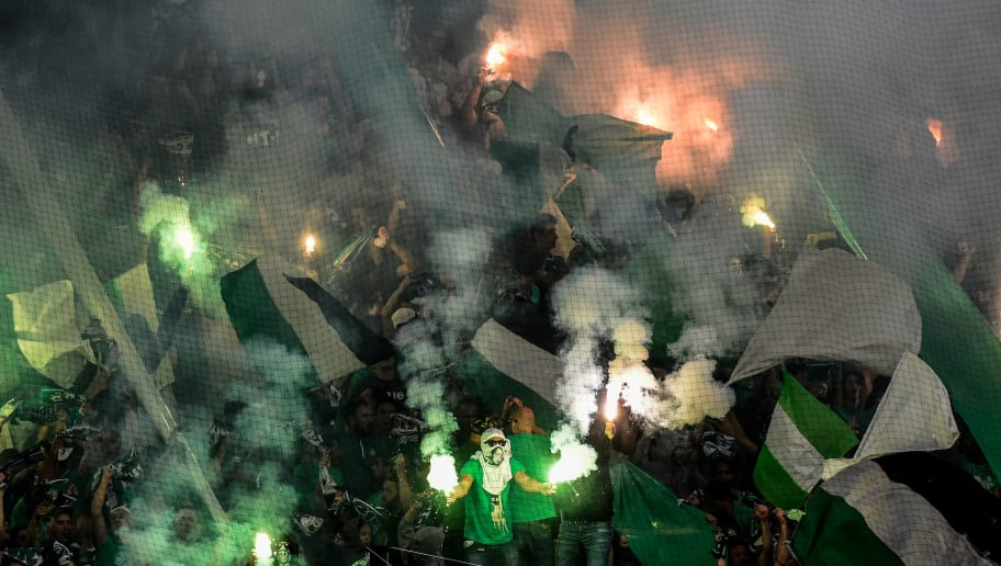 Saint-Etienne's supporters cheer during the French L1 football match Saint-Etienne (ASSE) vs Lille (LOSC) on May 19, 2018, at the Geoffroy Guichard Stadium in Saint-Etienne, central France. (Photo by JEAN-PHILIPPE KSIAZEK / AFP)        (Photo credit should read JEAN-PHILIPPE KSIAZEK/AFP/Getty Images)