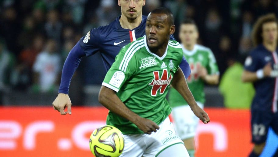 Paris Saint-Germain's Swedish forward Zlatan Ibrahimovic (L) vies with St Etienne's French defender Kevin Theophile-Catherine (R) during the French L1 football match between AS Saint-Etienne and Paris Saint-Germain on January 25, 2015  at the Geoffroy Guichard stadium in Saint-Etienne, Central France. AFP PHOTO / JEFF PACHOUD        (Photo credit should read JEFF PACHOUD/AFP/Getty Images)