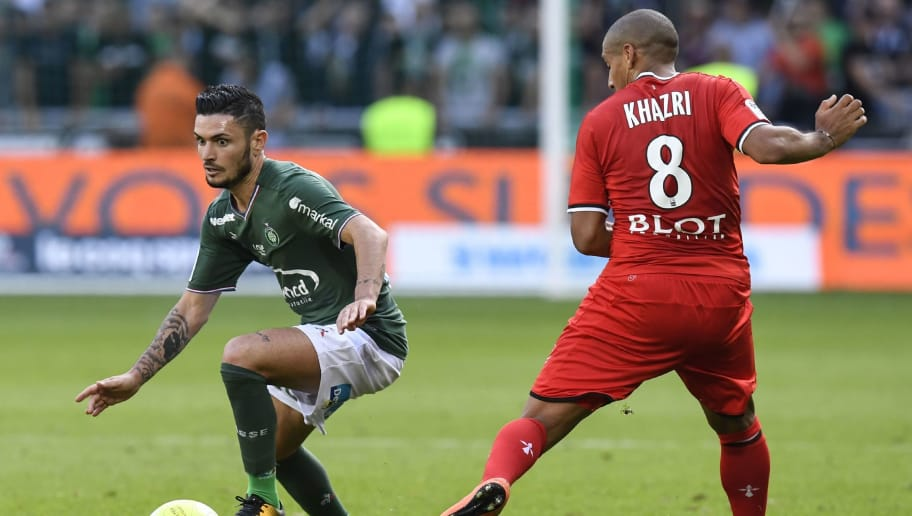 Saint-Etienne's French midfielder Remy Cabella (L) vies with Rennes' Tunisian midfielder Wahbi Khazri during the French Ligue 1 football match AS Saint-Etienne versus Stade Rennais FC on September 24, 2017 at the Geoffroy Guichard stadium in Saint-Etienne, central France. / AFP PHOTO / PHILIPPE DESMAZES        (Photo credit should read PHILIPPE DESMAZES/AFP/Getty Images)