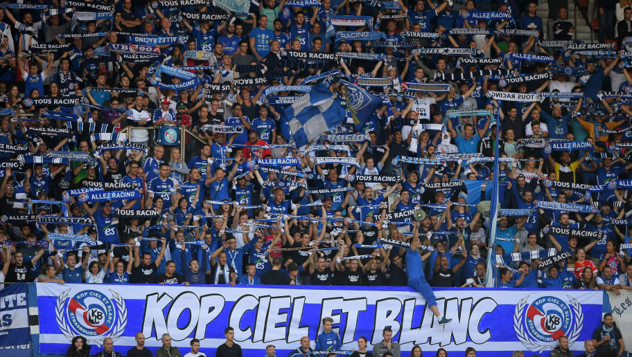 Strasbourg's supporters cheer during the French Ligue 1 football match between Strasbourg (RCSA) and Nantes (FCNA) on September 24, 2017 at the Meinau stadium in Strasbourg, eastern France. (Photo by PATRICK HERTZOG / AFP)        (Photo credit should read PATRICK HERTZOG/AFP/Getty Images)