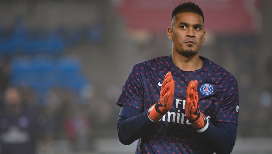 Paris Saint-Germain's French goalkeeper Alphonse Areola applauds as he arrives on the football pitch for a warm up session prior to the French L1 football match between Strasbourg and Paris Saint-Germain (PSG) at the Stade de la Meinau stadium, in Strasbourg, on December 5, 2018. (Photo by Patrick HERTZOG / AFP)        (Photo credit should read PATRICK HERTZOG/AFP/Getty Images)