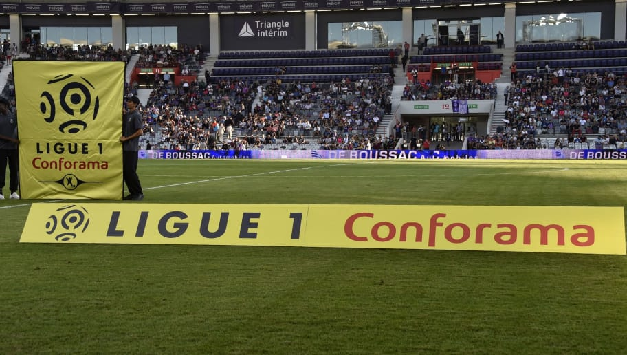 The new sponsor logo 'Ligue 1 - Conforama' is installed prior to the French Ligue 1 football match between Toulouse and Montpellier at the Municipal Stadium in Toulouse, southern France, on August 12, 2017. / AFP PHOTO / PASCAL PAVANI        (Photo credit should read PASCAL PAVANI/AFP/Getty Images)