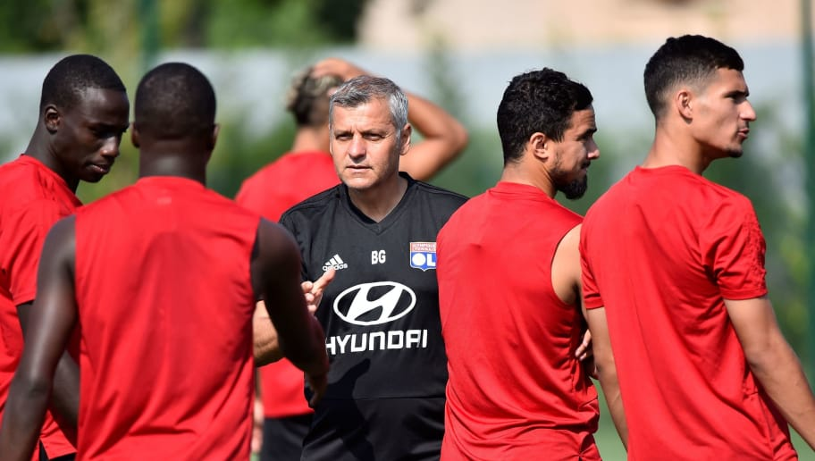 Lyon's French head coach Bruno Genesio (C) leads his players in a training session at the Groupama OL training center in Decines-Charpieu near Lyon, central-eastern France, on August 6, 2018. (Photo by ROMAIN LAFABREGUE / AFP)        (Photo credit should read ROMAIN LAFABREGUE/AFP/Getty Images)