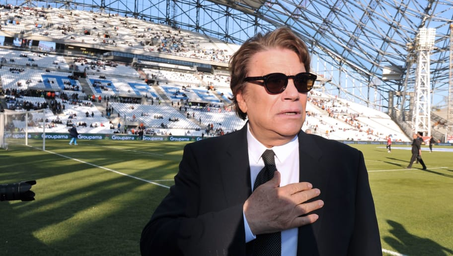 Former president of Olympique de Marseille (OM) Bernard Tapie (R) stands on the field before the start of the French L1 football match Olympique de Marseille (OM) versus Reims (SR) and the festivities marking the anniversary of OM's 1993 UEFA Champions League title at the Velodrome stadium in Marseille, southeastern France, on May 26, 2013.  AFP PHOTO/GERARD JULIEN / AFP PHOTO / GERARD JULIEN        (Photo credit should read GERARD JULIEN/AFP/Getty Images)