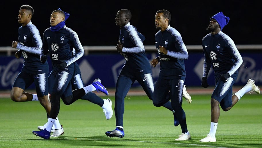 (LtoR) France's defender Presnel Kimpembe, France's forward Kylian Mbappe, France's forward Nabil Fekir, France's defender Ferland Mendy, France's forward Alassane Plea and France's midfielder Tanguy Ndombele run during a training session in Clairefontaine-en-Yvelines, near Paris, on November 13, 2018, as part of the team's preparation for the Nations League football match against the Netherlands and a friendly football match against Uruguay. (Photo by FRANCK FIFE / AFP)        (Photo credit should read FRANCK FIFE/AFP/Getty Images)