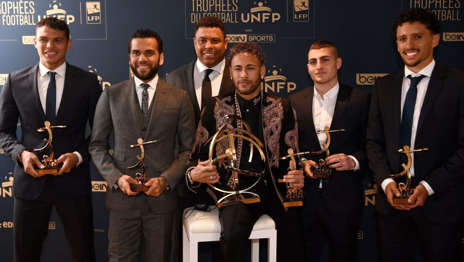 (from L) Paris Saint-Germain's Brazilian defender Thiago Silva, Brazilian defender Dani Alves, Former Brazilian international player Roanldo, Brazilian forward Neymar,  Italian midfielder Marco Verratti and Brazilian defender Marquinhos pose after the 27th edition of the UNFP (French National Professional Football players Union) trophy ceremony,  on May 13 , 2018 in Paris. (Photo by FRANCK FIFE / AFP)        (Photo credit should read FRANCK FIFE/AFP/Getty Images)
