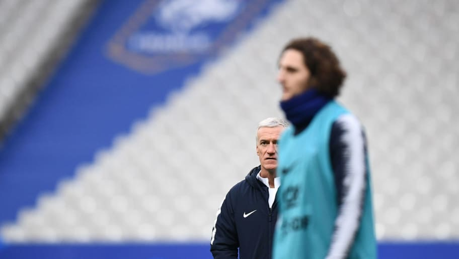 France's head coach Didier Deschamps (L) looks on as France's midfielder Adrien Rabiot walks past during a training session at the Stade de France in Saint-Denis, north of Paris, on March 22, 2018 on the eve of the international friendly football match against Colombia. / AFP PHOTO / FRANCK FIFE        (Photo credit should read FRANCK FIFE/AFP/Getty Images)