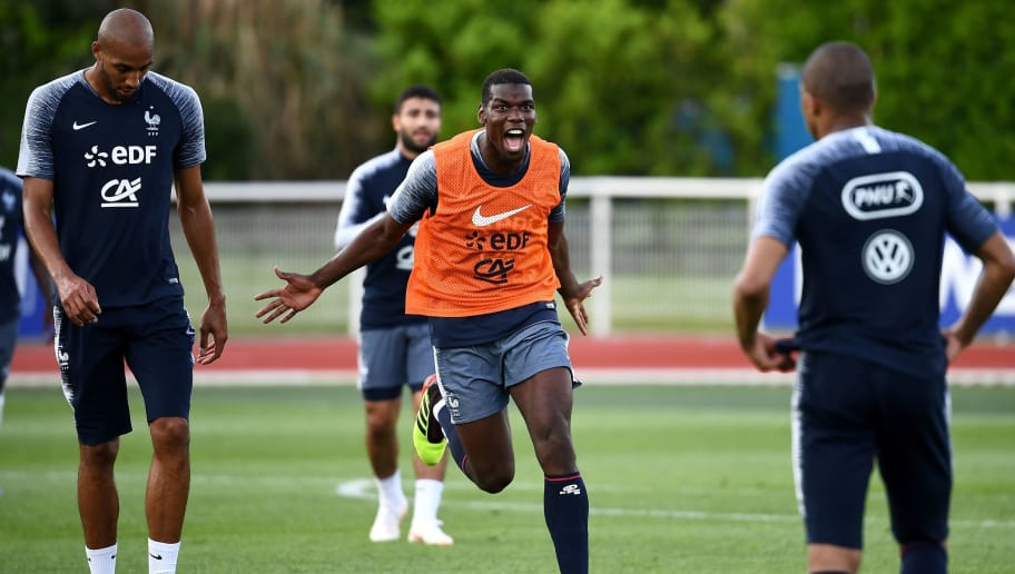 France's midfielder Paul Pogba (C) reacts next to France's forward Kylian Mbappe (R) and France's midfielder Steven N'zonzi at the end of a training session in Clairefontaine en Yvelines on May 30, 2018, as part of the team's preparation for the upcoming FIFA World Cup 2018 in Russia. (Photo by FRANCK FIFE / AFP)        (Photo credit should read FRANCK FIFE/AFP/Getty Images)