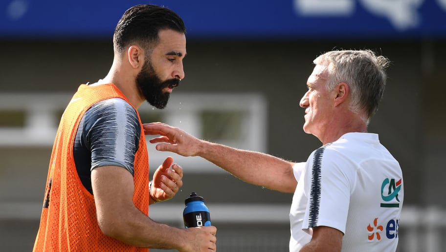France's defender Adil Rami (L) speaks with France's head coach Didier Deschamps during a training session in Clairefontaine en Yvelines on May 30, 2018, as part of the team's preparation for the upcoming FIFA World Cup 2018 in Russia. (Photo by FRANCK FIFE / AFP)        (Photo credit should read FRANCK FIFE/AFP/Getty Images)