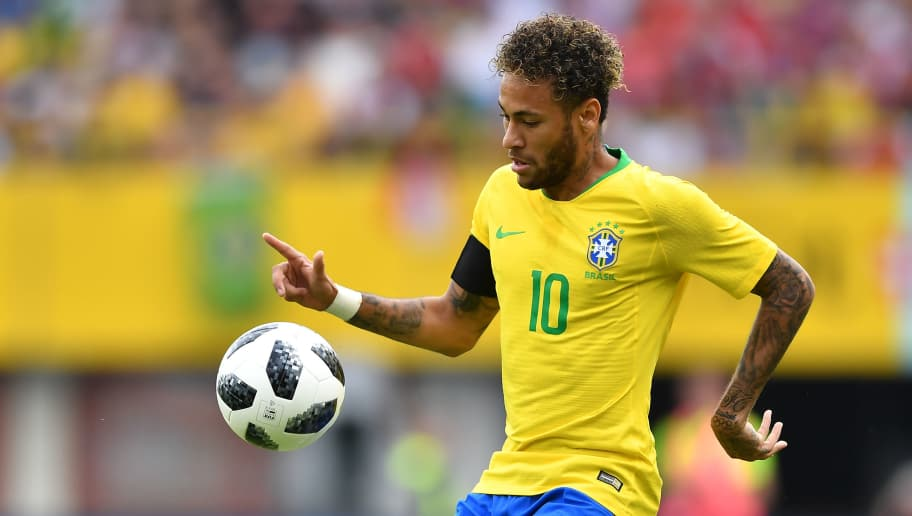 Brazil's forward Neymar eyes a ball during the international friendly footbal match Austria vs Brazil in Vienna, on June 10, 2018. (Photo by JOE KLAMAR / AFP)        (Photo credit should read JOE KLAMAR/AFP/Getty Images)