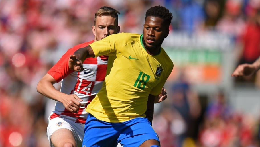 Brazil's midfielder Fred (R) vies with Croatia's midfielder Filip Bradaric during the International friendly football match between Brazil and Croatia at Anfield in Liverpool on June 3, 2018. (Photo by Oli SCARFF / AFP)        (Photo credit should read OLI SCARFF/AFP/Getty Images)