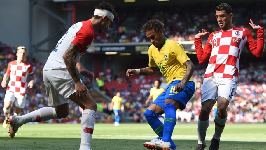 Brazil's striker Neymar (C) vies with Croatia's defender Sime Vrsaljko (L) and Croatia's midfielder Mateo Kovacic (R) in the build up to scoring the opening goal of the International friendly football match between Brazil and Croatia at Anfield in Liverpool on June 3, 2018. (Photo by Oli SCARFF / AFP)        (Photo credit should read OLI SCARFF/AFP/Getty Images)
