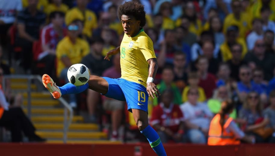 Brazil's midfielder Willian controls the ball during the International friendly football match between Brazil and Croatia at Anfield in Liverpool on June 3, 2018. (Photo by Oli SCARFF / AFP)        (Photo credit should read OLI SCARFF/AFP/Getty Images)