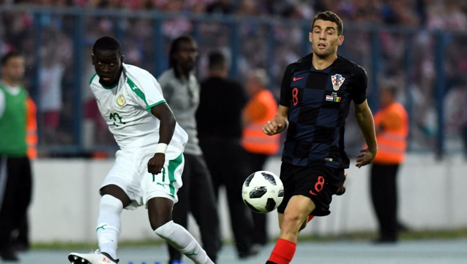 Croatia's midfielder Mateo Kovacic (R) vies with Senegal's midfielder Papa Alioune N'Diaye during a friendly football match between Croatia and Senegal at Gradski Stadium in Osijek on June 8, 2018. (Photo by Denis Lovrovic / AFP)        (Photo credit should read DENIS LOVROVIC/AFP/Getty Images)