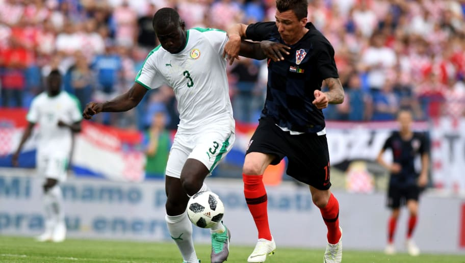 Croatia's forward  Mario Mandzukic (R) vies with Senegal's defender Koulibaly Kalidou during the international friendly football match between Croatia and Senegal in Gradski vrt stadium in Osijek on June 8, 2018. (Photo by Denis Lovrovic / AFP)        (Photo credit should read DENIS LOVROVIC/AFP/Getty Images)