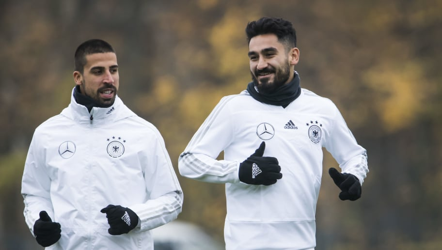 German national football team's Ilkay Guendogan ( R) and Sami Khedira run during a training session on November 9, 2017 at the training grounds of the Olympic stadium in Berlin, ahead of two friendly matches away to England. / AFP PHOTO / Odd ANDERSEN        (Photo credit should read ODD ANDERSEN/AFP/Getty Images)