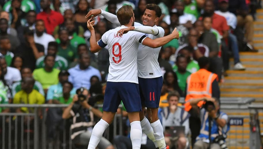England's striker Harry Kane (L) celebrates with England's midfielder Dele Alli after scoring their second goal during the International friendly football match between England and Nigeria at Wembley stadium in London on June 2, 2018. (Photo by Ben STANSALL / AFP)        (Photo credit should read BEN STANSALL/AFP/Getty Images)